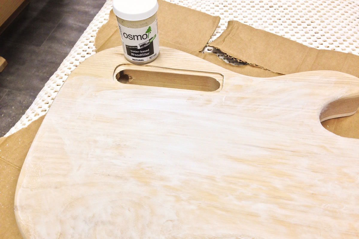 Grain is filled with Osmo wood filler to create a smooth surface for a flat lacquer finish