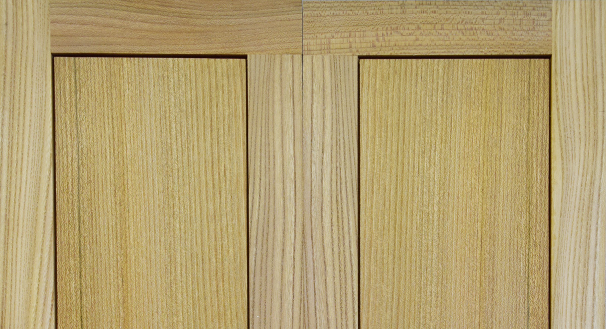Elm doors, book matched frame and panel