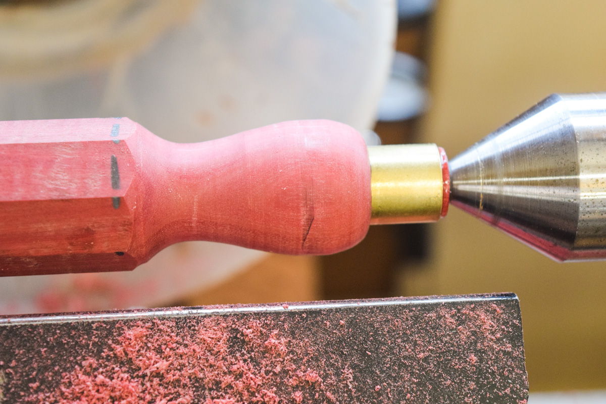 Turning the flared section of the handle
