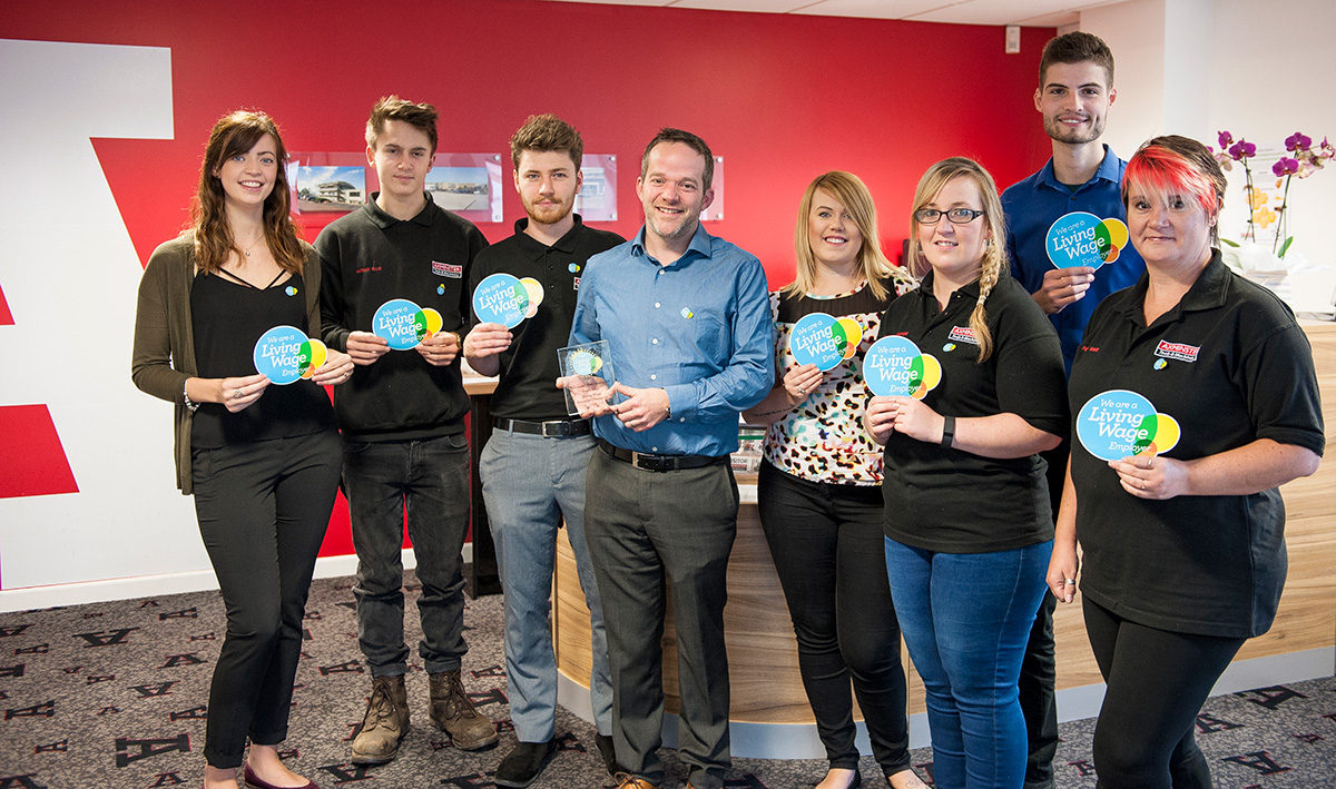 L to R: Harriet Searle, Nathan Ellis, Grant Jones, Alan Styles (Managing Director) with trophy, Maddie Edwards, Rachel Newton, Tom James and Fiona Gage.