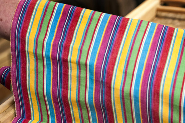 Folding deckchair fabric around deckchair frame
