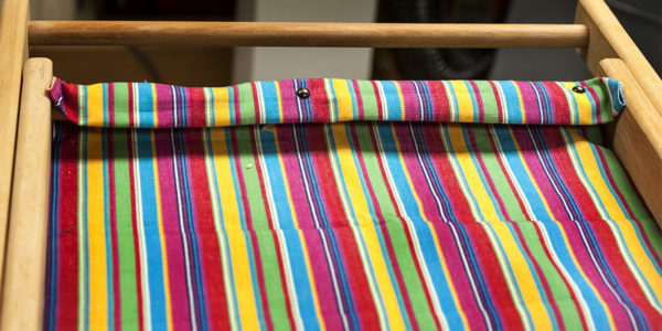 Tacking fabric to the frame of deckchair