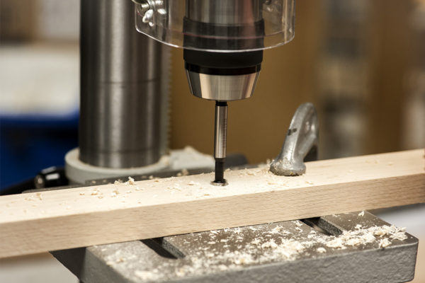 A Pillar drill and 12mm forstner bit is used to countersink 6mm holes