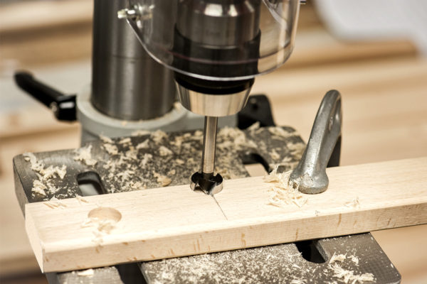 Cutting support slots on deckchair with pillar drill and forstner bit
