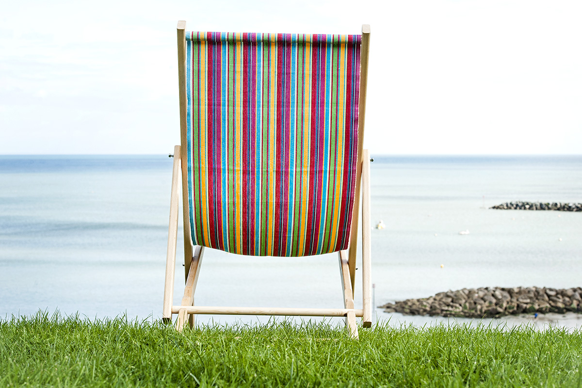 Finished deckchair On Grass Looking Out To Sea