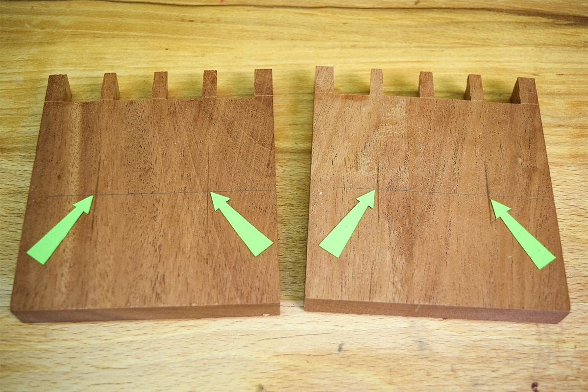 Two base sections of wood with 2 centre markings in each for screw holes.