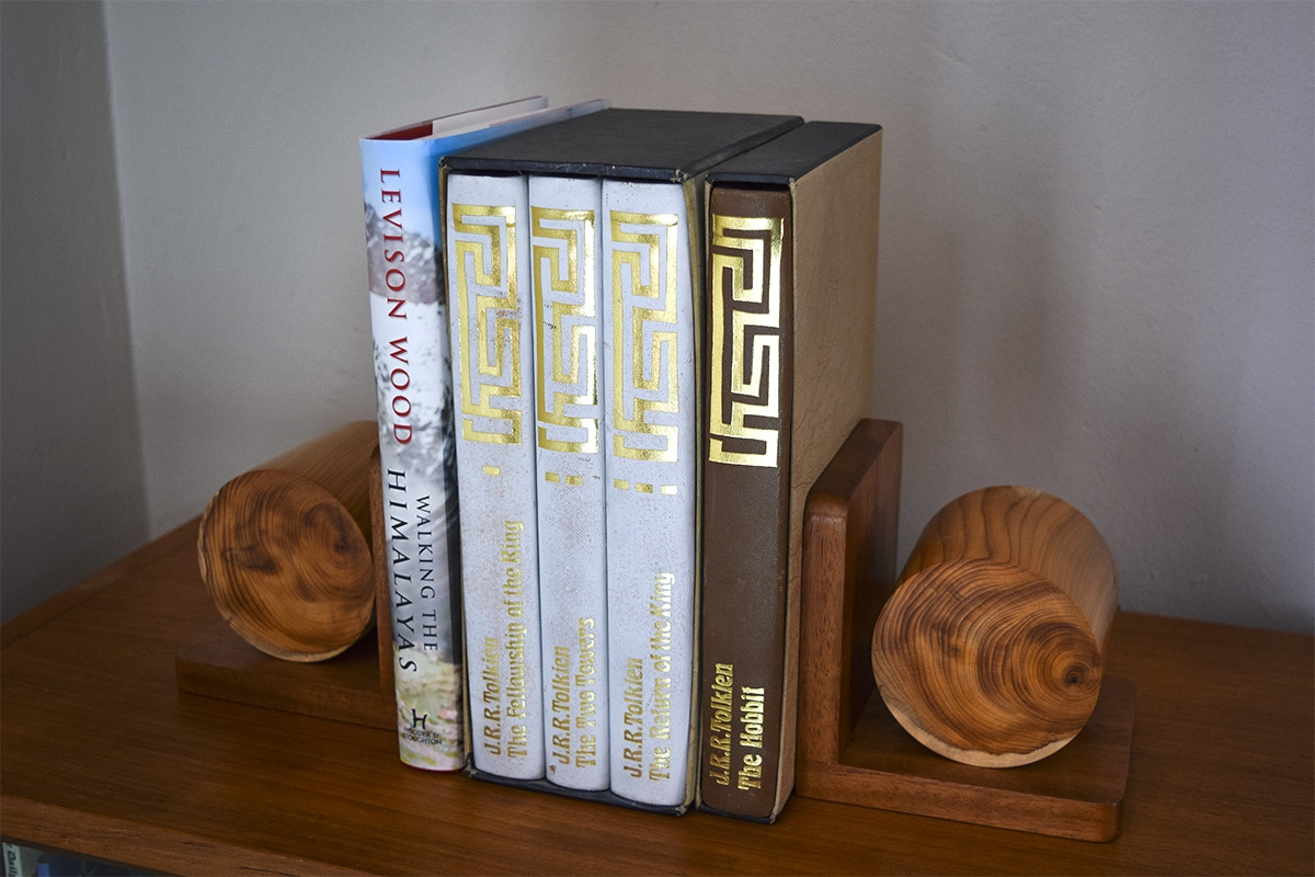 Completed bookends on the shelf with books stacked.