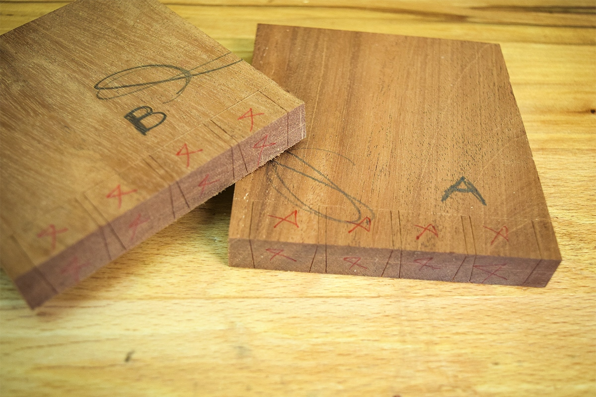 Two sections of Mahogany marked out pin boards.