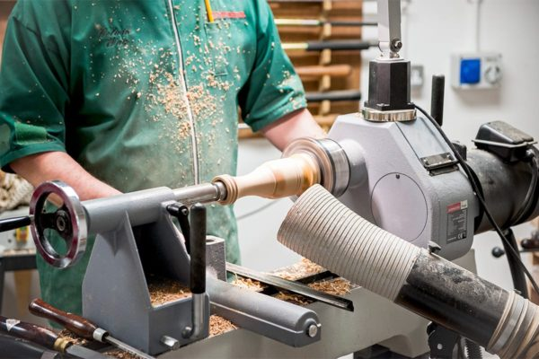 Woodturning the main body to design on the lathe.