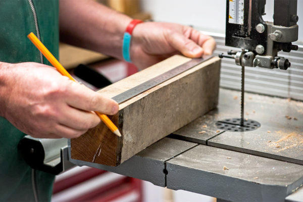 Measuring wood blank to the size of the mechanism.