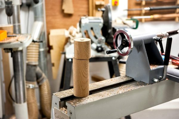 Roughed out sections of the top and main body on the lathe.