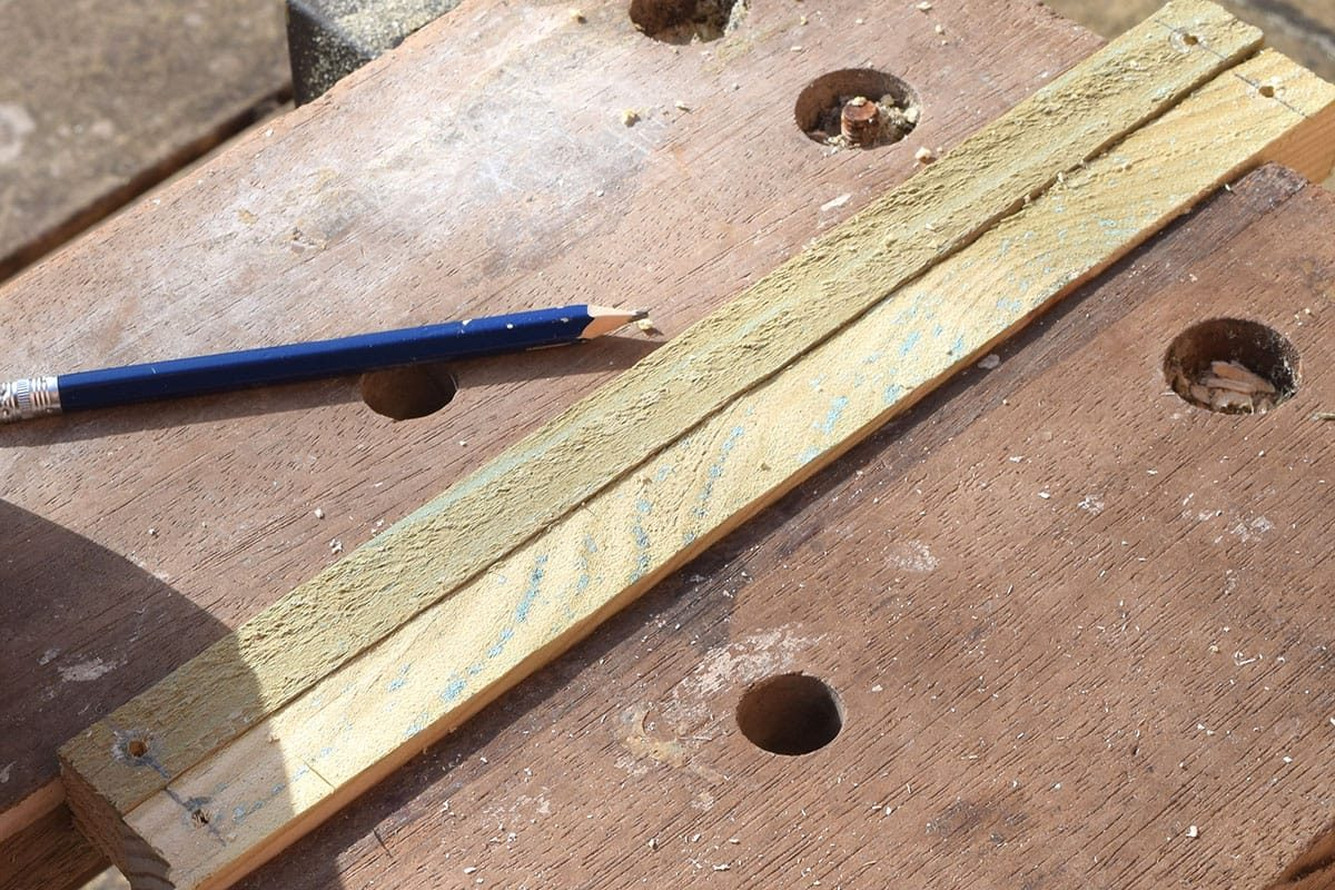Drill 3.5mm pilot holes at each end