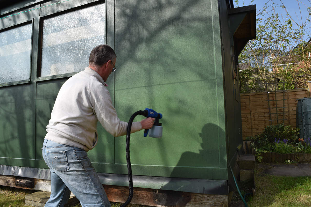 paint sprayer in action