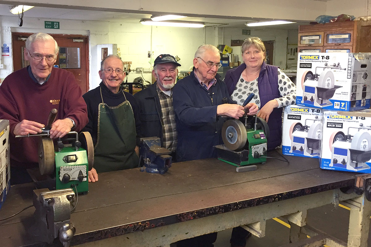Tormek machines and volunteers at the Tools for Self Reliance HQ