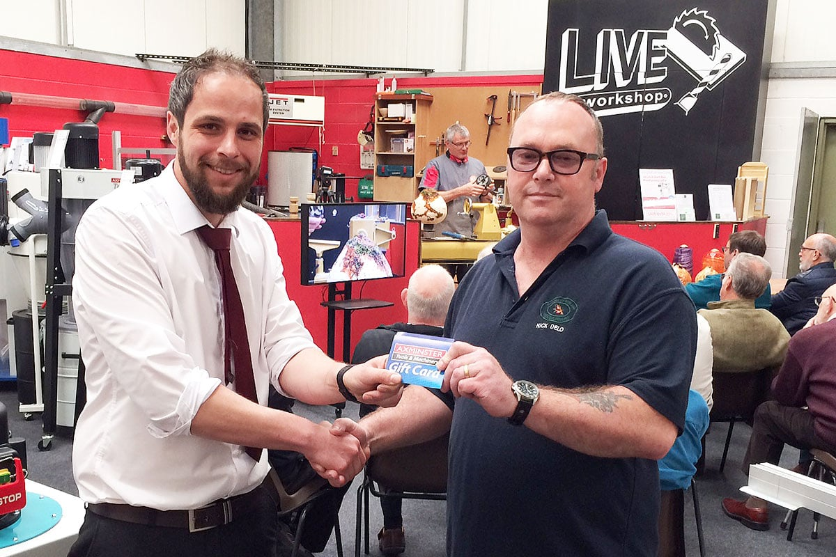 Store Manager David Johns presenting a £50 Gift Card to Nick Delo of the Garden of England Woodturners