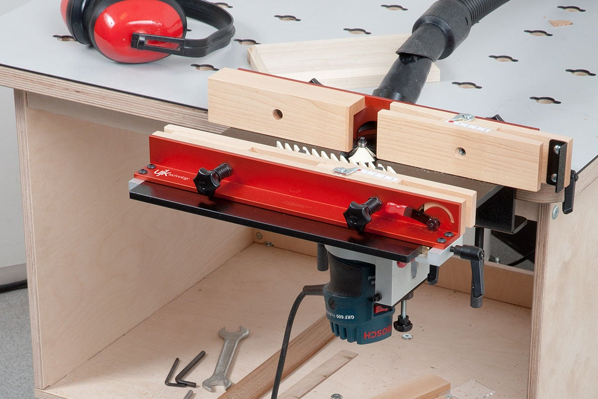 Router table clamped to a workbench