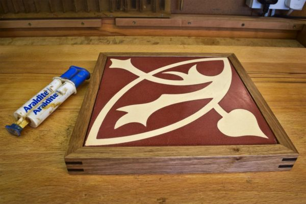Use epoxy to glue in the tile