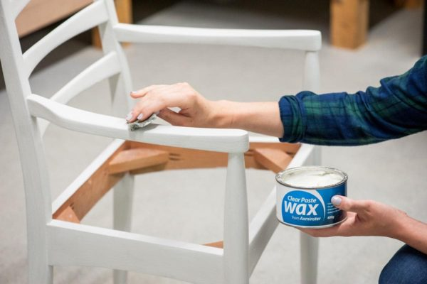 Applying Axminster wax to the chair