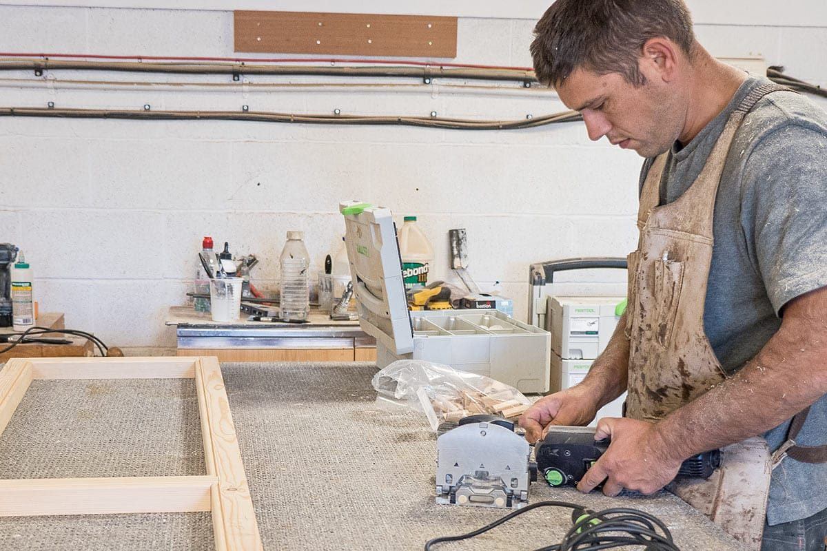 Festool DOMINO DF 500 Q-Set Jointing Machine being used to make a window in a workshop
