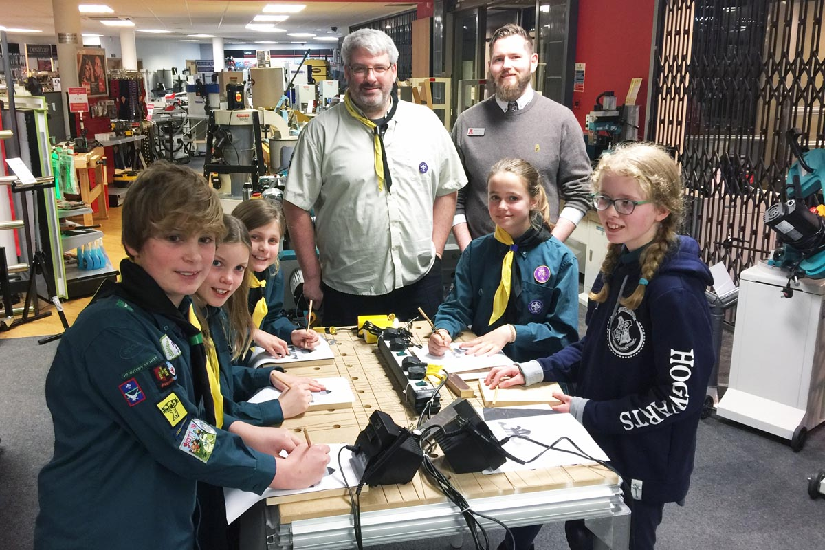 Scout Leader Richard Brice-Nye (Design and Production at Axminster HQ) with Store Manager Matthew Youngs at the Pyrography table