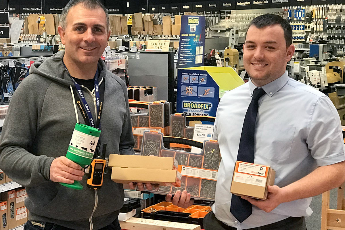 Stephan (right) with Malcolm Jones, who was in-store collecting a donation of WoodSpur screws and the countertop collection tin