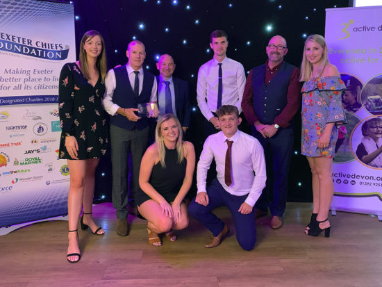 Collecting an award at the Devon Sports Awards event