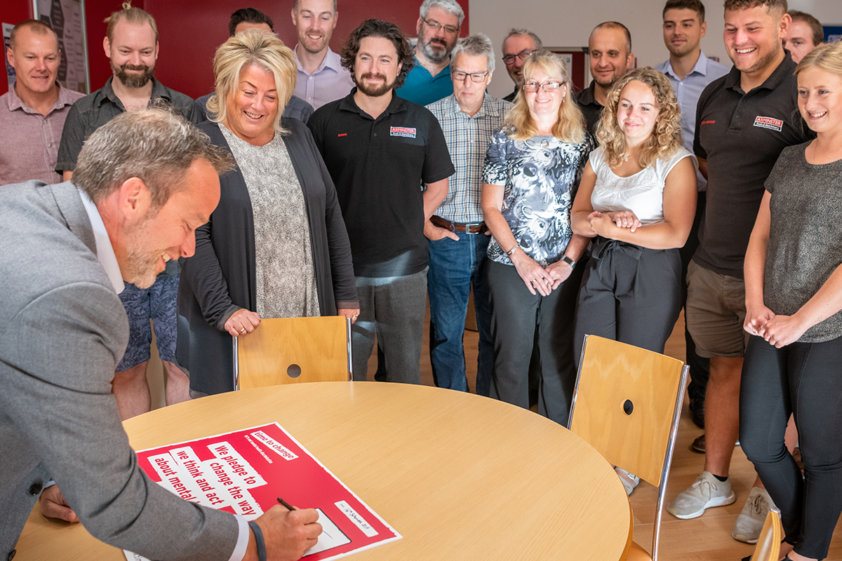 Alan Styles signing the pledge